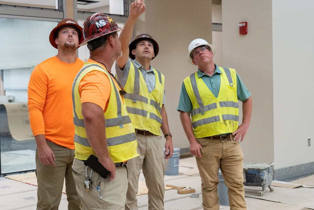 WAR Construction workers on job site